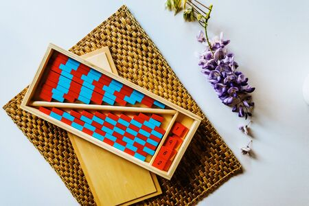 Red and blue montessori wood stripe to learn arithmetic in class.