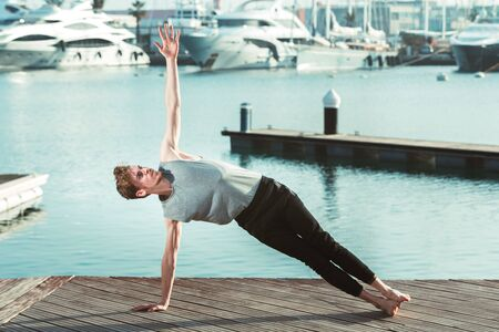 Vasisthasana, the lateral plank for yoga practitioners, intermediate posture.