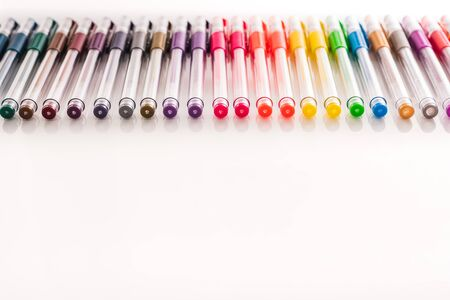 school supplies to paint with ordered colored markers for children on a white background