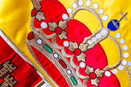 Close-up of the crown of the Spanish flag, macro of the royal design detail.