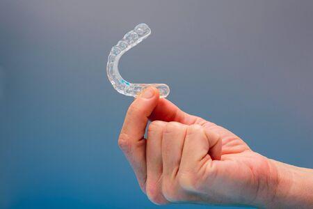 Dental aligner used by dental doctors isolated on blue background. Standard-Bild