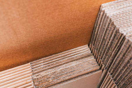 Home moving using corrugated cardboard boxes as protection material, detail. Stock Photo