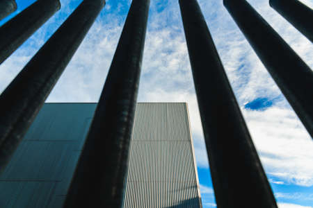 Vertical steel bars, a fence that separates and protects buildings from the street.
