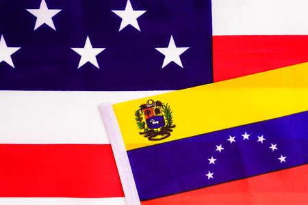 Flag of Venezuela on the American national flag, two countries with conflict between them.