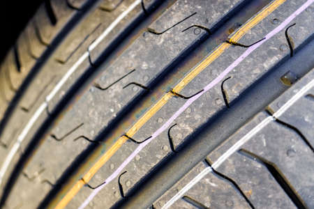Detail of the grooves of a new car tire. 스톡 콘텐츠