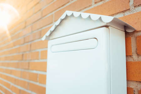 Traditional paper mailings dwindle over time, and mailboxes tend to disappear. Copy space.