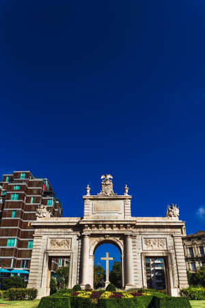 Porta del Mar, a square in the center of Valencia with a large stone construction, with saturated colors. Stock Photo