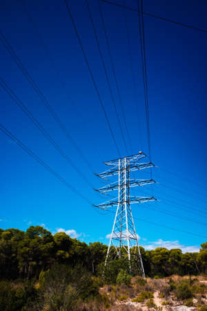 Electricity is transported by thick cables attached to metal towers.