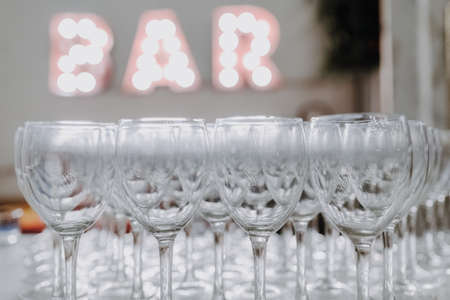 Empty glasses on a bar counter for drinking alcohol.