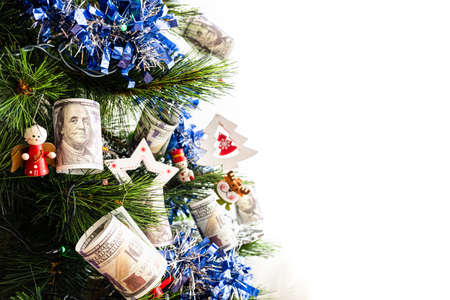 Detail of christmas tree with decorations and dollar bills wishing to earn money in the new year eve, with blank copy space. Stock fotó