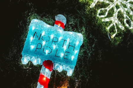 The North Pole is where Santa Claus lives, a sign indicating direction. Stock fotó