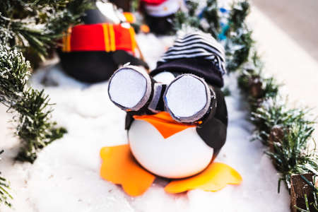 Funny penguin dolls with a camera, Christmas decorations.
