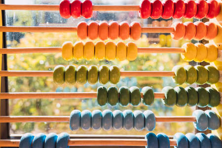Detail of the colored beads of a wooden abacus, elementary educational material.