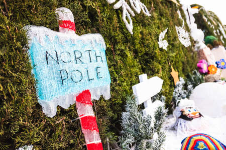 Christmas decoration of a signpost of the luminous North Pole.