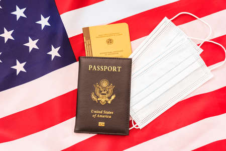 American passport with vaccination record on a flag. Stock fotó