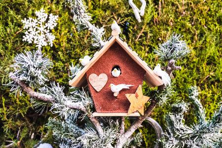 Outdoor Christmas decoration, fake bird house.