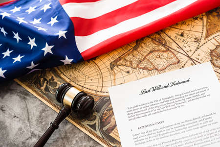 Document of last wills and testament, background with gavel of a lawyer and American flag.