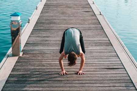 Bakasana or Crane Pose you keep in balance on your hands and with your legs touching your arms, yoga.