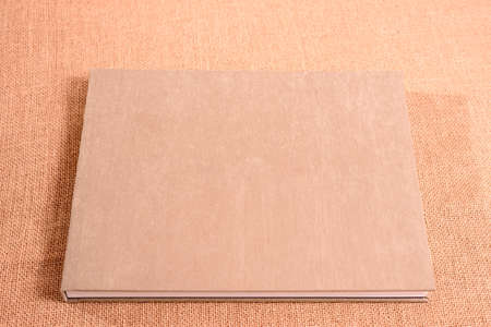 Velvet covers of a photo book with room for text.
