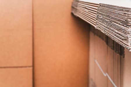 Home moving using corrugated cardboard boxes as protection material, detail. Stock fotó