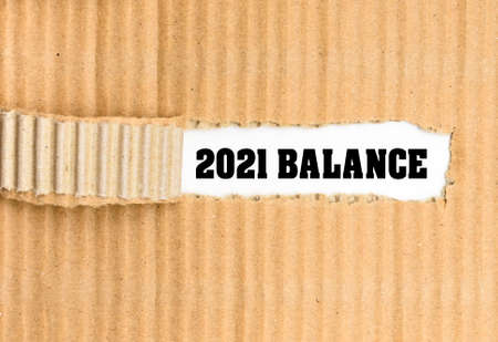 Balance text, on the white background on the torn corrugated business paper.
