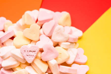Love wishes and I Love You messages engraved on a sweet heart-shaped candy.