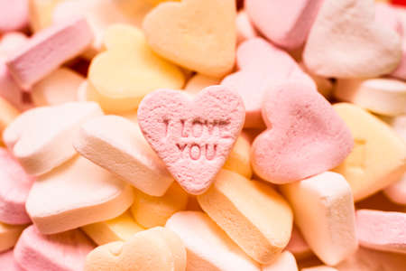 Love word engraved in a sweet romantic heart-shaped candy to give to lovers.