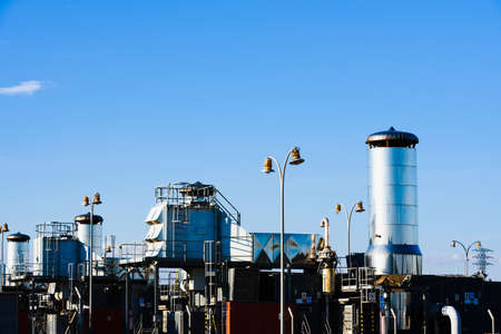Industrial facility with tall towers to propel gas to the city.