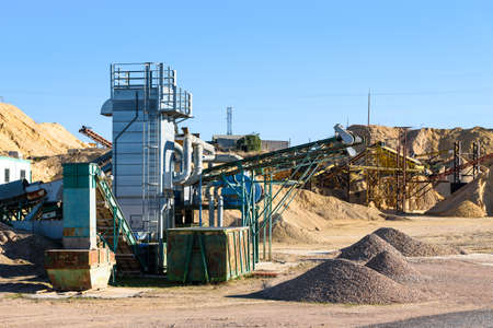 Machinery in a rock quarry to crush and sand the stone.
