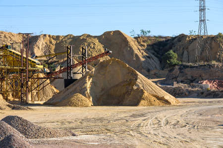 Pile of gravel and sand piled up in a quarry for sale and use in construction. Sajtókép