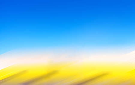 Defocused abstract background of a blue sky and yellow horizon with motion blur effect. Banque d'images