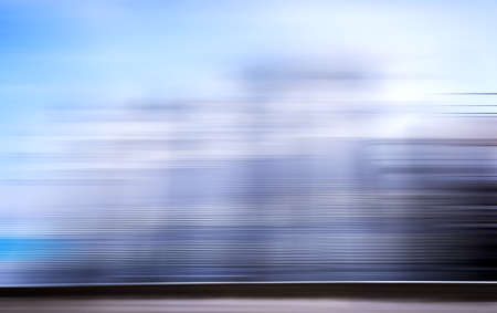 Abstract background with horizontal blue lines and lighting mixed with motion blur effect.