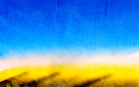 Background, with rough and aged texture, out of focus of a blue sky and yellow horizon with motion blur effect. Banque d'images