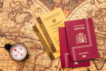 Valencia, Spain - September 6, 2020: Spanish passport next to the international vaccination card