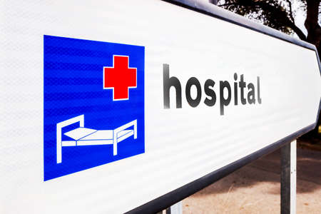 Road sign indicating the direction of a hospital