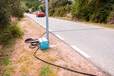 Black pneumatic tube along the road to measure speed and number of vehicles