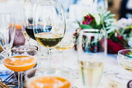 Glasses arranged on the diners table at a celebration of a party.