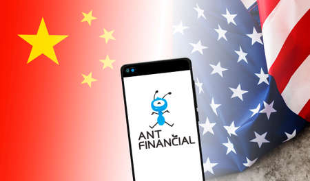 Valencia, Spain - March 19, 2021: Logo of Ant Financial, the world's largest fintech, Alibaba's payment platform, between flags of China and America.
