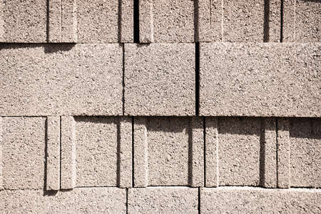 Detail of a wall of cement ballut blocks, construction material. Imagens