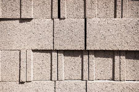 Detail of a wall of cement ballut blocks, construction material. 免版税图像