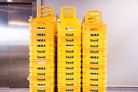Valencia, Spain - April 1, 2021: Stack plastic baskets from the Ikea furniture store.