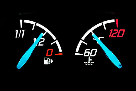 Half fuel level indicator light on a car dashboard.