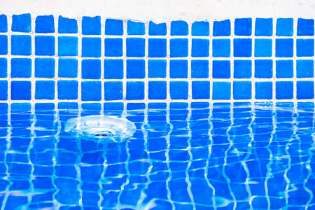 Drain on the wall of a swimming pool