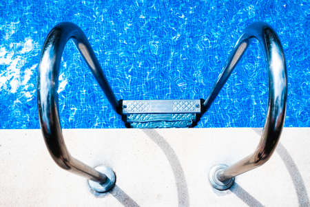 A pool with a metal ladder to access it and bathe in summer. 免版税图像 - 167076218