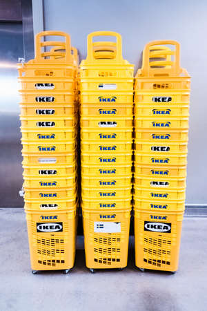 Valencia, Spain - April 1, 2021: Stack plastic baskets from the Ikea furniture store. Redactioneel