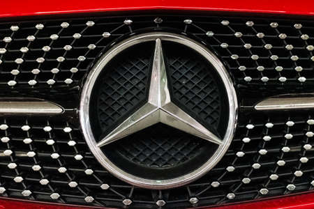 Valencia, Spain - April 1, 2021: Mercedes Benz star, badge on the radiator of a red sports car. 新闻类图片