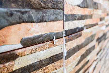 Tile spacers, plastic pieces to separate tiles during installation.