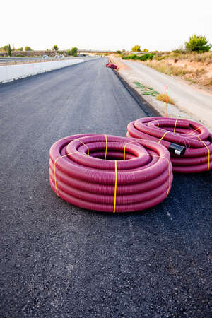 Detail of protective tubes to cover an underground electrical installation. 免版税图像