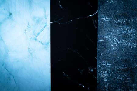 Three different dark marble materials arranged vertically.