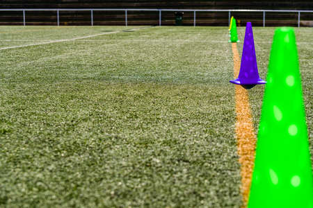 Colored cones on an pitch artificial grass sports court with copy space.